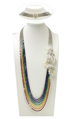 Multi-Strand Necklace with Swarovski Crystal Beads and Pearls and Delica® Seed Beads: It's the rainbow crystal part I like on this. But I also like how the top part leads to the rainbow, very pretty.