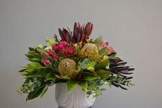 Pop of colour from everlasting & proteas with banksias and mixed leucadendrons