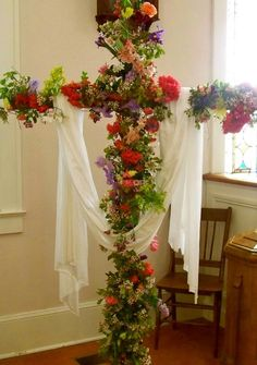 The tradition of Flowering The Cross on Easter morning. The flowering cross is based on legend that the cross itself burst into bloom the moment Jesus died.