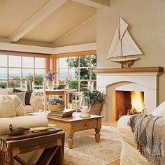 Creams and browns create a soothing neutral backdrop for the colors of nature outside | Coastalliving.com