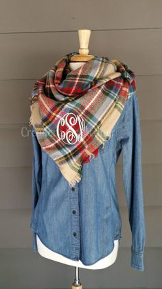 These monogrammed blanket scarves are a must have for fall and winter. The options are endless. There are unlimited ways to wear them, you can even wrap it as a shawl or add a belt and you have a great plaid poncho. Scarves are oversized and 100% woven acrylic. Please note that all computer screens are different. The sample scarf is a cream/tan multi with linen thread. It is a lighter tan.  Font choices and thread colors are all listed, PLEASE make sure you include the font, thread color and…