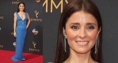 Shiri Appleby in emerald and diamond drop earrings and a diamond ring by Piaget