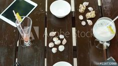 Stock Video of A frame blend stop motion (top view) on the beach with a table in the sea sand, snacks, drinks and cocktails, on a tropical island in Seychelles, close shot. at Adobe Stock Cocktails, Drinks, Stop Motion, Top View, Seychelles, Stock Video, Stock Footage, A Table, Adobe