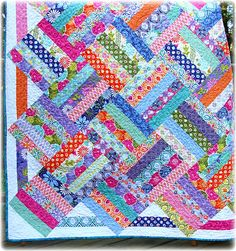 Terrain Quilt | Flickr - Photo Sharing!  5 strip jelly roll blocks set on point with HST ends