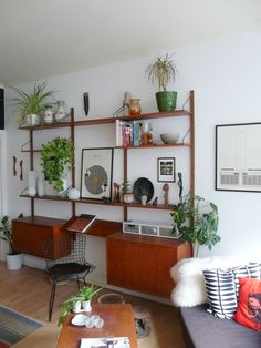 teak wall unit-maybe something like this in black w/file cabinets and baskets underneath?