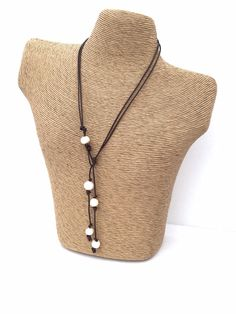Perfect for a rustic wedding this Lovely Pearl & Leather lariat necklace is strung with Large Freshwater Pearls on black round leather cord.  Cultured freshwater 10 mm Pearl colors are white. These pearls are of an organic shape and not perfectly round like the very expensive cultured pearls.   Self closing using the pearls through the loop,   Approximately 22 inches long to the loop then the drops are another 6 inches.  Third anniversary gift or Valentine gift under 40    To view other l...