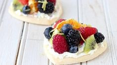 This recipe for Mini Rainbow Fruit Pizza is easy, bright, and totally rainbow-tastic. It serves a crowd and wows their tastebuds, too!
