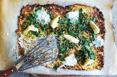Cauliflower Pizza topped w/ blue cheese, marinated artichokes, pesto and wilted spinach.