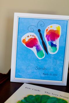 Footprint butterfly - We used a rainbow colored stamp pad for the footprint wings and a black marker to make the body.