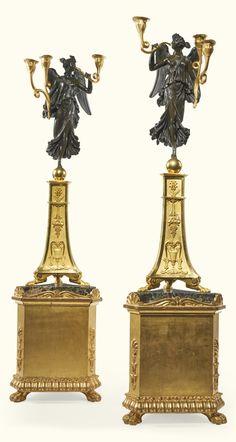 A pair of gilt-bronze and patinated bronze three-light candelabra, the design attributed to Duguers de Montrosier, Empire, circa 1805