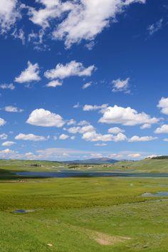 Green Fields Under Blue Cloudy Sky