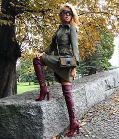 Blonde in dress and oxblood leather thigh boots
