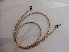 Cordon de lunettes, mini tubes bronze et perles de rocaille doré