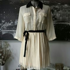 Cream & Black Chiffon Pleated Shirt Dress Cream & Black Chiffon Shirt Dress with Pleated Skirt & Removable Belt. Elastic waist. Brand: Charlotte Russe Size: Labeled L (Best fits M/L) RP: $32.99 New With Tags Charlotte Russe Dresses Mini