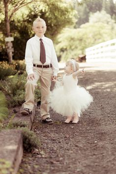 These kids are so cute... on their best behavior, even in pink boots. #westernwedding #countrywedding
