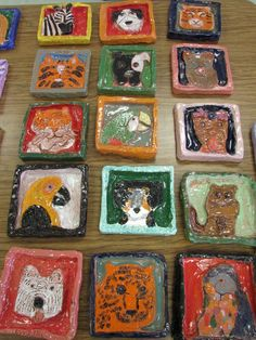 "Ceramic animal relief sculptures by my 5th grade students; approx. 7"" X 7""; lesson by art teacher: Susan Joe"