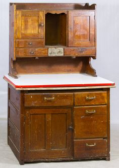 Lot 93: Primitive Oak Hutch by Ellwell Cabinet Company; Upper section having wood panel doors and wood and tin drawers on porcelain surface; lower section having wood panel doors and drawers