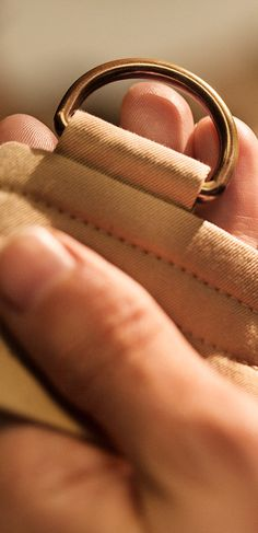 Crafting the belt of the heritage trench Coat – four lines of stitches are sewn onto the belt for durability and structure