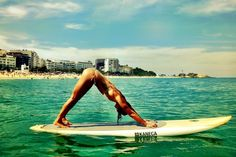 Yoga In Brazil Adho Muka Svanasana with Praia de Ipanema in the Background Dogs Days on Ipanema beach, Rio de Janeiro Loved and pinned by www.downdogboutique.com