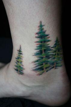 Green spruce tattoo on foot