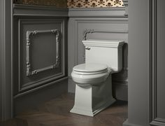 Glenbury™ toilet seat     Memoirs® Stately toilet     This toilet's traditional design detailing and smooth lines provide a beautiful complement to the scrollwork of the wood trim.
