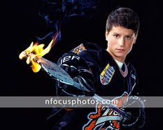 nFocus senior photos Boy with a hockey stick on fire in Crystal Lake, IL