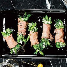 Roast Beef and Arugula Bundles - At only 65 calories per serving, this appetizer will win over starch fans, too.