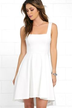 You obviously have some style momentum, so make sure the Course of Action Ivory High-Low Dress keeps the ball rolling! Wide shoulder straps meet a squared-off neckline and fitted waist. A full knit skirt descends, forming a lovely high-low silhouette. Hidden back zipper.