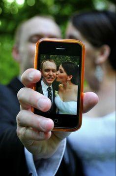 Bride & Groom on Cellphone | Marc Pagani Louisiana http://www.weddingphotousa.com/city/new-orleans/marc-pagani-photography/