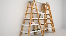 bookcase made from double ladder   Or go the easy route and just prop the ladder against the wall for a ...
