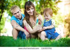 parents with a baby in a beautiful summer park