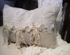 Love this look - I think I would like even better to use the old crocheted doilies overlapping the top of a muslin pillow - the buttons and streaming bits (ribbon, muslin?) are probably my favorite parts - would be more elegant to use silk rosebuds instead of buttons, and battenburg lace instead of doilies - via You Could Make That
