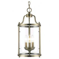 """Bring classic style to your living room, dining room, or foyer with this handsome pendant, showcasing a glass shade and an antique brass finish.    Product: PendantConstruction Material: Steel and glassColor: Antique brassAccommodates: (3) 60 Watt incandescent type B bulbs - not includedDimensions: 19.5"""" H x 9"""" Diameter"""