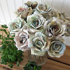 Map Flowers. Could be a super cute way to add color to the centerpieces of storybook flowers.
