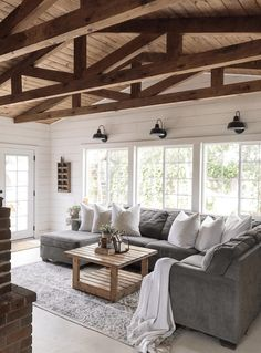 Top 5 Friday: How To Get The Modern Farmhouse Look Wood vaulted beam ceiling, shiplap, grey sectional