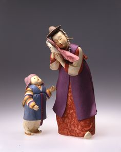 """by Nobuko AKIYAMA. Born February 24, 1928. Recognized as a holder of the important intangible cultural property, """"Costume Dolls"""", on May 10, 1996."""