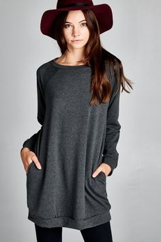 This raglan sleeve sweatshirt dress is the ultimate closet staple. It's easy to throw on with leggings, skinnies or tights for an easy, stylish look. You can pair it with a fedora and jeans for an easy weekend ensemble or dress it up with a scarf, earrings and heels for a night out. Not only is it extremely versatile, it comes in a variety of bright and neutral colors to mix and match!