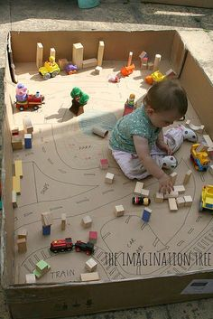 Perfect for not-yet-walking babies, The Imagination Tree's cardboard box town is simple enough to re-create. Draw a city scene — including roads, parks, train tracks, and more — on the bottom of a huge cardboard box, add some wooden building blocks, and voilà, you have a build-your-own city!  Source: The Imagination Tree