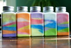 Materials:  Paper or paper plates to mix on -  Colored Chalk - Salt -  Small Jars -- pour a small amount of salt at a time (depending on childs age).. then 'color' with the chalk (the chalk dust mixes with the salt) then layer and repeat! Great project for all ages, my daughter did this as a teen..