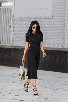 A tee tucked into culottes and lace-up heels.
