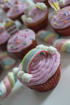 Rainbow cupcakes for a My Little Pony Party! I made these for my 4 year old's Birthday. Cheap way to make 24 cupcakes to feed a crowd. I used a vanilla cake mix, purple food dye in a basic vanilla icing mix, some rainbow candy strips from Bulk Barn and marshmallows. Easy Peasy!