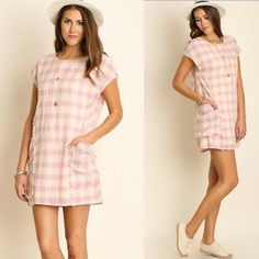 "Pretty In Pink Plaid Dress Perfect for the spring time! Pink and cream mixed plaid with pocket detailing by the waist. The seam lines are slightly frayed to add some simple detailing. Made of a cotton and poly blend. Sizes S striped embellished. Measurements: bust 44"" length 35"" Dresses Mini"