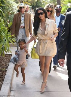 Matchy matchy: Accompanied by daughter North, Kim seemed to have plumped for the same shad...