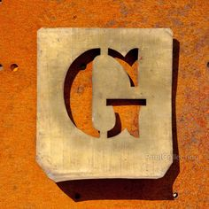 "This letter ""G"" is but one of a very large collection of metal type stencils for labeling business packaging. Dates back to the 1940?s. Photographed here on aåÊbeautifullyåÊrusted steel sheet."