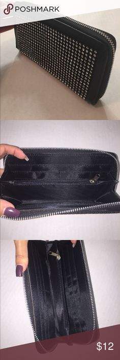 NWOT Black studded wallet Black studded wallet. Brand new without tags, never used. Zippers and plenty of room for cards, etc. Bags Wallets