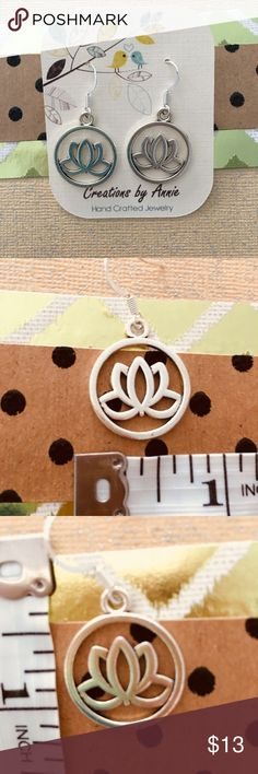 Silvertone Lotus Earrings The Lotus symbolizes the purity of heart and mind. These earrings are delicate and make great gifts. Jewelry Earrings