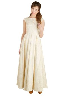 For a look that will last in your true love's mind, don this pleated, full-length gown for your special day! This sleeveless, structured frock touts a buttercream hue, a mesh overlay with swirled satiny embroideries, and an elegantly dipped back - making your presence romantically swoon-worthy.