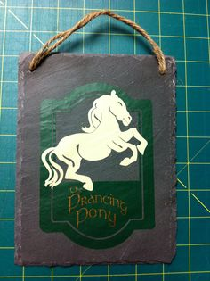 The Prancing Pony sign I made for my Lord of the Rings decor.