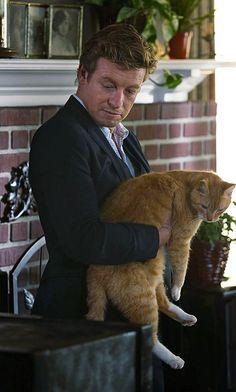 Patrick Jane holds a cat