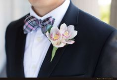 The groom's pink, black, and green plaid bow-tie with the pink-freckled orchid boutonniere is everything. We're smitten | Museum of Science and Industry in Downtown Chicago | Miller + Miller Photography